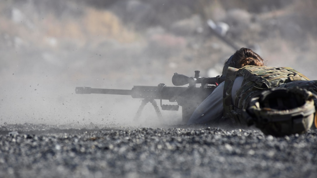 Senior Airman Erika Andresen, 92nd Civil Engineer Squadron explosive ordinance disposal technician, fires a Barret M107 caliber rifle as part of weapons familiarization training at Coulee Dam, Washington, Sept. 26, 2018. A part of EOD's mission set is irregular warfare, which requires them to be familiar with a variety of weapons systems in order to perform the mission. (U.S. Air Force photo/Airman 1st Class Lawrence Sena)