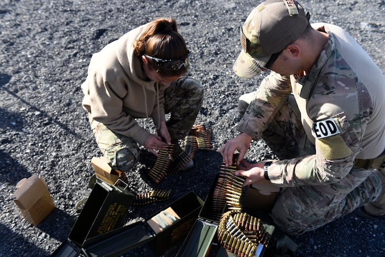 Senior Airman Erika Andresen and Senior Airman Taylor Preza, 92nd Civil Engineer Squadron explosive ordinance disposal technicians, prepare ammunition prior to weapons qualifications at Coulee Dam, Washington, Sept. 26, 2018. Since a deployment tasking can happen at an time, EOD technicians need to maintain annual weapons qualifications in order to stay mission ready. (U.S. Air Force photo/Airman 1st Class Lawrence Sena)