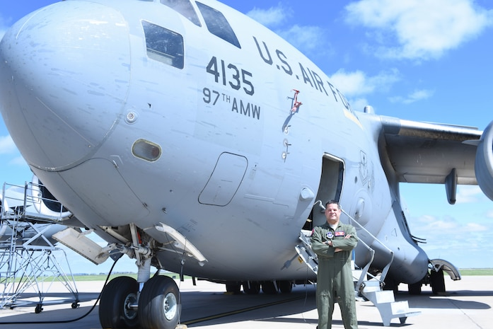 U.S. Air Force Lt. Col. Carlos Berdecia, commander of the 58th Airlift Squadron, stands in front of a C-17 Globemaster III, Sept. 24, 2018, at Altus Air Force Base, Okla. Berdecia's family has more than a century of combined military service.  (U.S. Air Force photo by Amn Dallin Wrye)