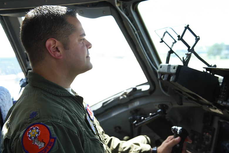U.S. Air Force Lt. Col. Carlos Berdecia, commander of the 58th Airlift Squadron, operates a C-17 Globemaster III, Sept. 24, 2018, at Altus Air Force Base, Okla. Berdecia was born and raised in Puerto Rico and continued his family's tradition of serving in the military.  (U.S. Air Force photo by Amn Dallin Wrye)