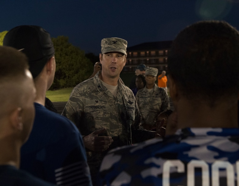 Col. Robert Pedersen, commander of the 97th Mission Support Group, congratulates the 97th Logistics Readiness Squadron football team on winning the 97th Air Mobility Wing Flag Football Championships Sept. 28, 2018 on Altus Air Force Base, Okla. The 97th Operations Support Squadron and the LRS played two games against each other with OSS winning the first, and LRS winning the second to become the champions. (U.S. Air Force photo by A1C Jeremy Wentworth)