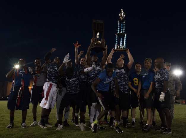 The 97th Logistics Readiness Squadron football team celebrates winning the 97th Air Mobility Wing Flag Football Championships Sept. 28, 2018 on Altus Air Force Base, Okla. The 97th OSS and the LRS played two games against each other with the 97th Operations Support Squadron winning the first, and LRS winning the second to become the champions. (U.S. Air Force photo by A1C Jeremy Wentworth)