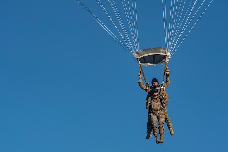 Col. Jennifer Short, front, 23d Wing commander, and Kirby Rodriguez, 563d Rescue Group instructor, prepare to land following a tandem jump, Sept. 27, 2018, over Davis-Monthan Air Force Base, Nev. Effective 1 Oct., the 563d RQG and its associated maintenance squadrons will be realigned from the 23d WG to the 355th Fighter Wing. (U.S. Air Force photo by Staff Sgt. Ryan Callaghan)