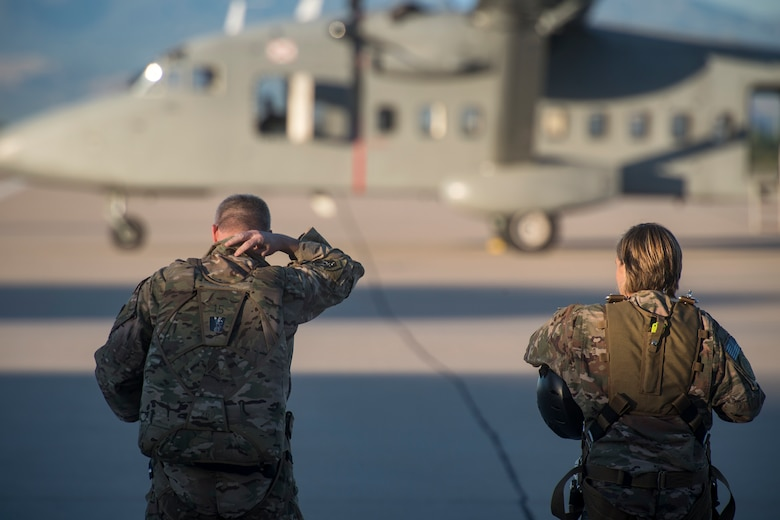 Col. Jason Pifer, left, 563d Rescue Group commander, and Col. Jennifer Short, 23d Wing commander, prepare to board a C-23 Sherpa prior to a high-altitude, low-opening jump, Sept. 27, 2018, at Davis-Monthan Air Force Base, Nev. Effective 1 Oct., the 563d RQG and its associated maintenance squadrons will be realigned from the 23d WG to the 355th Fighter Wing. (U.S. Air Force photo by Staff Sgt. Ryan Callaghan)