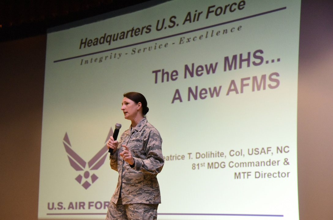 U.S Air Force Col. Beatrice Dolihite, 81st Medical Group commander, briefs Keesler Medics on the Keesler Medical Center's transition to the Defense Health Agency during a commander's call at the Welch Theater on Keesler Air Force Base, Mississippi, Oct. 1, 2018. (U.S. Air Force photo by Kemberly Groue)