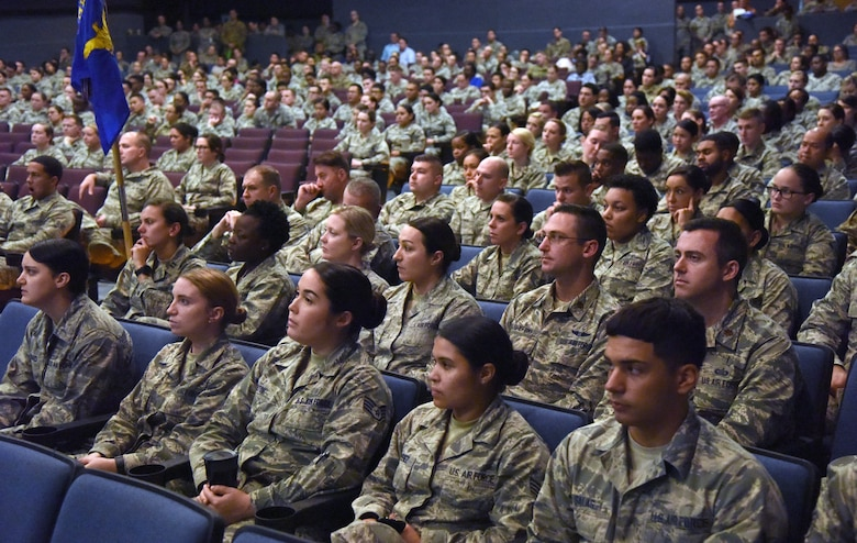 Keesler Medics attend a commanders call hosted by Col. Beatrice Dolihite, 81st Medical Group commander, at the Welch Theater on Keesler Air Force Base, Mississippi, Oct. 1, 2018. Dolihite briefed on the Keesler Medical Center's transition to the Defense Health Agency with the first phase of the transition beginning today. (U.S. Air Force photo by Kemberly Groue)