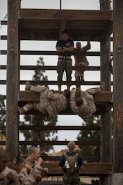 Recruits with Lima Company, 3rd Recruit Training Battalion, climb an obstacle during a confidence course at Marine Corps Recruit Depot San Diego, Sept. 24.
