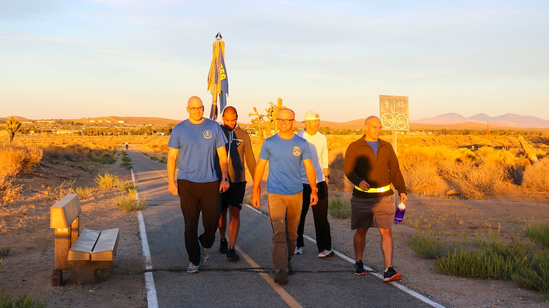 Participants of the Fight for Life Suicide Prevention and Awareness Event finish the final leg of the 12-hour relay at Edwards Air Force Base, California, Sept. 28-29. The event was an overnight relay ruck march, run or walk. (U.S. Air Force photo by Giancarlo Casem)