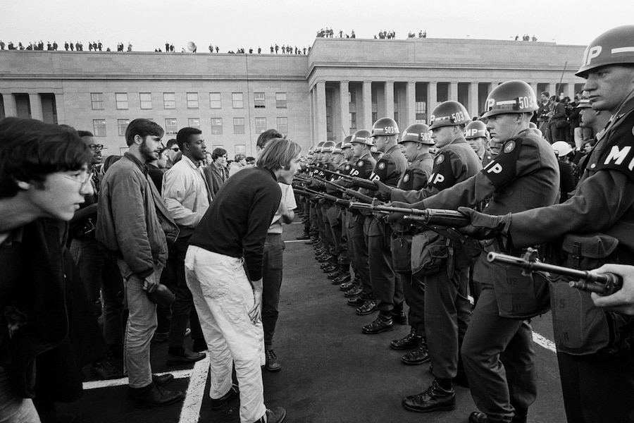 Army military police officers use weapons to block a crowd demonstrating against the Vietnam War outside the Pentagon, Va., Oct. 21, 1967.