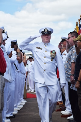 PHNSY & IMF's Command Master Chief James R. Schneider (Center) is piped ashore during his retirement ceremony at the USS Bowfin memorial in Pearl Harbor. Schneider is retiring from the Navy after 29 years of dedicated service.
