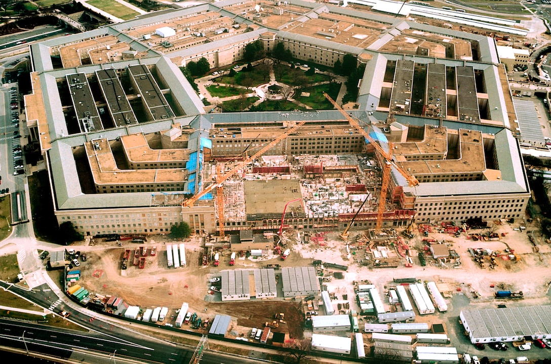 Construction crews work on floors and walls at the Pentagon