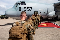 Marines with the Joint Humanitarian Assistance Survey Team, 3rd Marine Expeditionary Brigade, board a KC-130J Hercules aircraft on Kadena Air Force Base, Sept. 27, 2018.