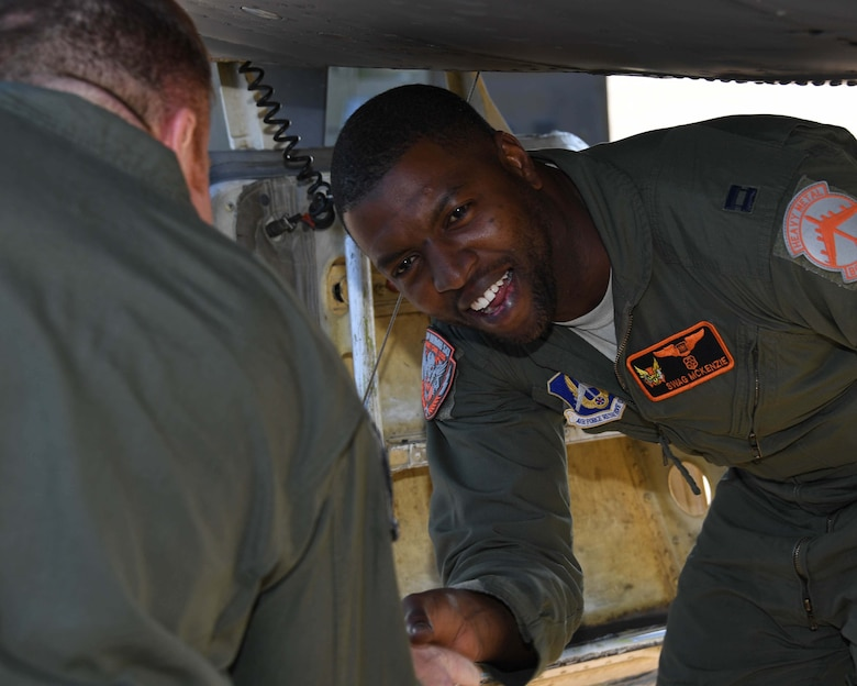 U.S. Air Force Capt. Dane McKenzie, 343rd Bomb Squadron electronic warfare officer, is all smiles after arriving at Fairford, England, Sept. 5, 2018.  McKenzie overcame a variety of obstacles in his civilian and military life to achieve his dream of flying with the Air Force.  (U.S. Air Force photo by Master Sgt. Ted Daigle)