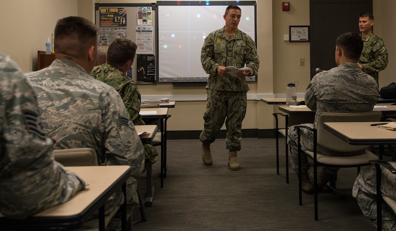U.S. Navy Master-at-Arms 1st Class Johnathon Post, 628th Security Forces Squadron Shore Installation Management Basic Boat Coxswain Course instructor, teaches a SIMBBC class Sept. 26, 2018, at Joint Base Charleston-Weapons Station, S.C. The SIMBBCC curriculum arms security forces members with skills needed to conduct harbor patrol missions and covers techniques including man overboard drills, pier approaches, towing and anchoring.