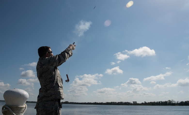 U.S. Air Force Staff Sgt. Curtis March, 628th Security Forces Squadron patrolman, shoots off a pencil flare during a Shore Installation Management Basic Boat Coxswain Course Sept. 26, 2018, at Joint Base Charleston's Naval Weapons Station, S.C. The SIMBBCC curriculum arms security forces members with skills needed to conduct harbor patrol missions and covers techniques including man overboard drills, pier approaches, towing and anchoring.