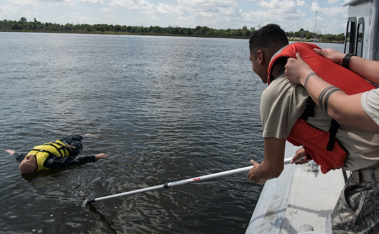 U.S. Air Force Senior Airman Marco Deleon, 628th Security Forces Squadron patrolman, participates in a man overboard drill during a Shore Installation Management Basic Boat Coxswain Course Sept. 26, 2018, at Joint Base Charleston's Naval Weapons Station, S.C. The SIMBBCC curriculum arms security forces members with skills needed to conduct harbor patrol missions and covers techniques including man overboard drills, pier approaches, towing and anchoring.