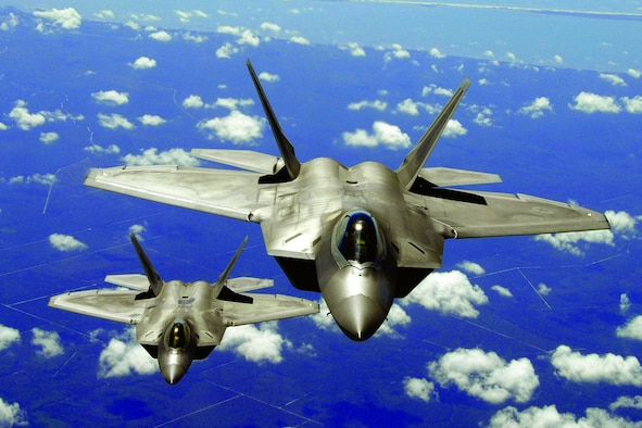 Two F-22 Raptors from Tyndall Air Force Base, Fla., participate in a training exercise. (U.S. Air Force photo by Senior Master Sgt. Thomas Meneguin)