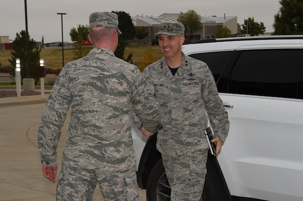 Col. Troy Endicott, 460th Space Wing commander, greets Maj. Gen. Stephen Whiting, 14th Air Force commander, Air Force Space Command, Sept. 28, 2018, on Buckley Air Force Base, Colorado. Whiting leads approximately 16,000 members responsible for providing strategic missile warning, nuclear command, control and communication, position, navigation and timing, space situational awareness, satellite operations, space launch and range operations. (U.S. Air Force photo by Senior Airman Codie Collins)