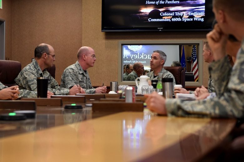 Col. Troy Endicott, 460th Space Wing commander, briefs Maj. Gen. Stephen Whiting, 14th Air Force commander, Air Force Space Command, Sept. 28, 2018, on Buckley Air Force Base, Colorado. Whiting is responsible for leading and guiding a diverse team of Airmen charged with protecting and defending critical U.S. and allied space capabilities. (U.S. Air Force photo by Senior Airman Codie Collins)