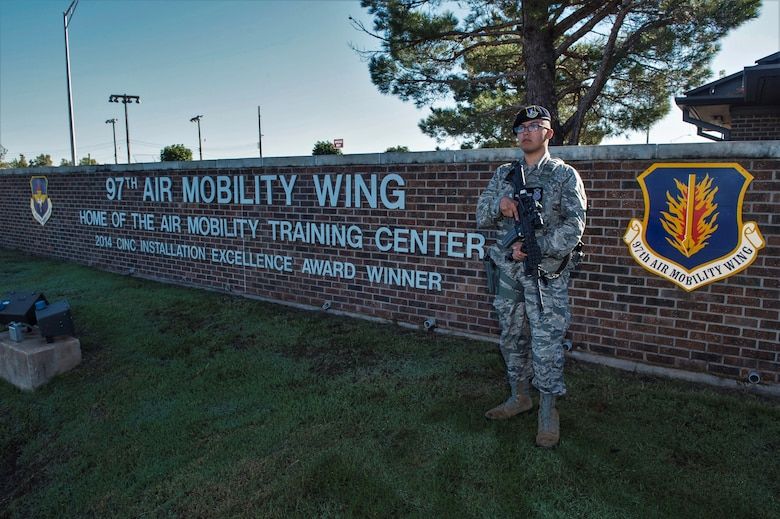 U.S. Air Force Airman 1st Class Andrew Rivera, response force member assigned to the 97th Security Forces Squadron, stands outside of the main gate, Sept. 27, 2018, at Altus Air Force Base, Okla. First response situations require appropriate responses, so quality hands-on training is mandatory for being prepared in these situations. (U.S. Air Force photo by Senior Airman Cody Dowell)