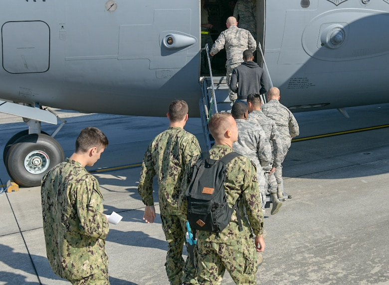 Airmen and Sailors board a C-17 Globemaster III on the flightline Oct. 2, 2018, at Joint Base Charleston, S.C. The service members were preparing for an incentive flight, which they earned by distinguishing themselves within their respective units. Leadership from the 628th Air Base Wing and the 437th Airlift Wing collaborated to provide flying opportunities for non-aircrew service members.