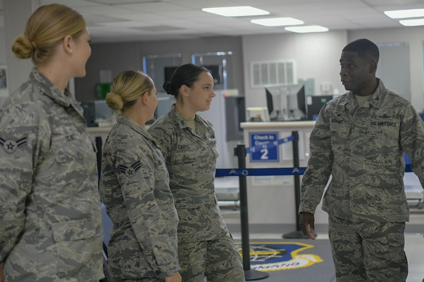 Col. Terrence Adams, Joint Base Charleston commander, speaks with a group of Airmen at the Passenger Terminal Oct. 2, 2018, at Joint Base Charleston, S.C. The service members were preparing for an incentive flight, which they earned by distinguishing themselves within their respective units. Leadership from the 628th Air Base Wing and the 437th Airlift Wing collaborated to provide flying opportunities for non-aircrew service members.