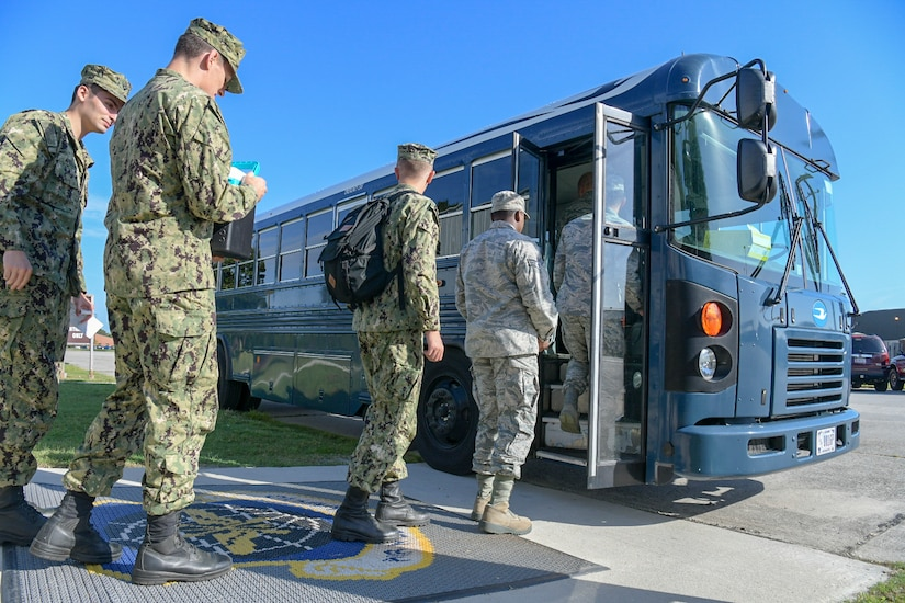 Airmen and Sailors board a bus at the Passenger Terminal Oct. 2, 2018, at Joint Base Charleston, S.C. The service members were preparing for an incentive flight, which they earned by distinguishing themselves within their respective units. Leadership from the 628th Air Base Wing and the 437th Airlift Wing collaborated to provide flying opportunities for non-aircrew service members.
