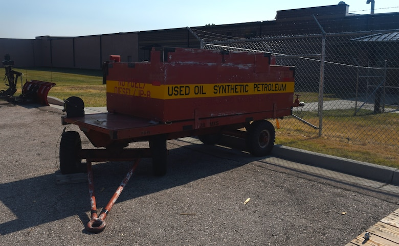 An oil trailer, similar to what was used in the SpillRaider trailer conversion, is still in use at Ellsworth Air Force Base, S.D., Sept. 17, 2018. The oil tank is removed from the deck of the trailer and replaced with one industrial-steel storage chest and two heavy-duty plastic storage chests. The storage chests are filled up with a fuel pump, absorbents and personal protective equipment for Airmen to use while cleaning up fuel on the flight line. (U.S. Air Force photo by Airman Christina Bennett)