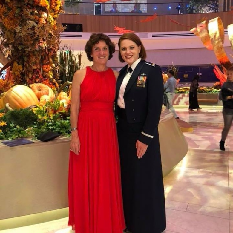 Linda Ambard, a violence prevention integrator at the 509th Bomb Wing at Whiteman Air Force Base, Missouri, left, stands with her daughter, U.S. Air Force Maj. Emily Short, during the Air Force Symposium dinner Sept. 19, 2018 at National Harbor, Maryland. Ambard and her daughter attended the dinner for the official release of the Gold Star Family video that Ambard narrated. (Courtesy photo)