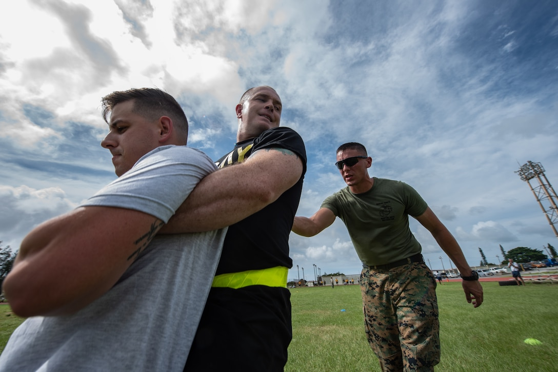 U.S. Army Spc. Tanner Moran, carries U.S. Air Force Staff Sgt. Colin Casey, both Okinawa Joint Experience Green Team students, during the Okinawa Joint Fitness Challenge Sept. 26, 2018, at Kadena Air Base, Japan. The OJFC was a portion of the OJE that enabled students to bond while overcoming obstacles and challenges faced in the battlefield. (U.S. Air Force photo by Staff Sgt. Micaiah Anthony)