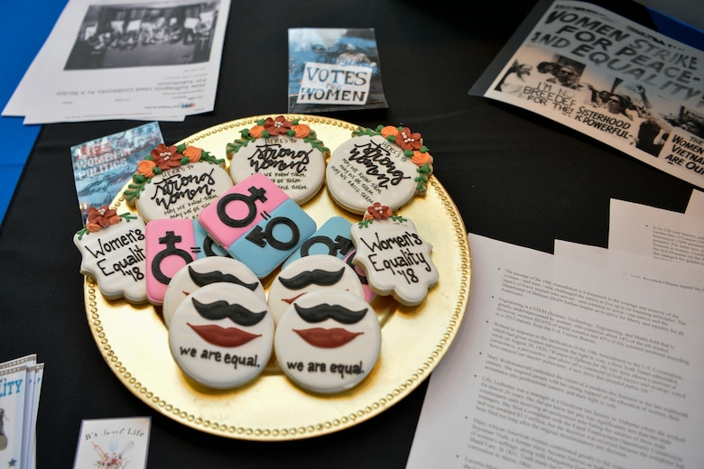 The Women's History Month observance stand at the 86th Airlift Wing's Diversity Day offered cookies as prizes to attendees participating in their trivia questions on Ramstein Air Base, Sept. 28, 2018. The event encompassed 10 annual observances with educational stands, cuisines and cultural performances. (U.S. Air Force photo by Staff Sgt. Nesha Humes Stanton)