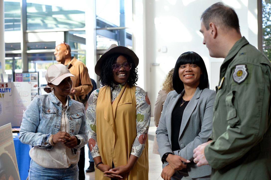 Kaiserslautern Military Community members speak with Brig. Gen. Mark R. August, 86th Airlift Wing commander at the 86th AW's Diversity Day on Ramstein Air Base, Sept. 28, 2018. The event aimed to enhance cross-cultural and cross-gender awareness while promoting harmony among all military members, their families, and the DOD civilian workforce. (U.S. Air Force photo by Staff Sgt. Nesha Humes Stanton)