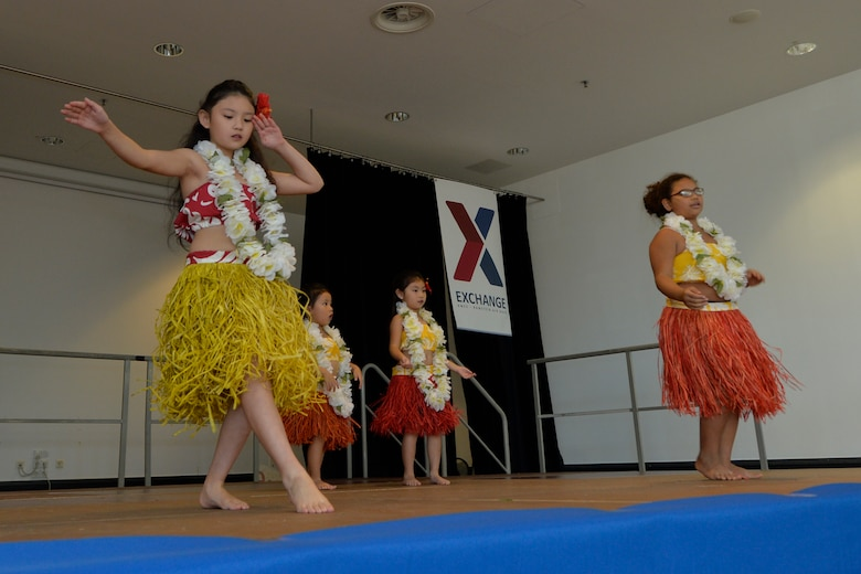 Kaiserslautern Military Community members perform a native hula dance during the 86th Airlift Wing's Diversity Day on Ramstein Air Base, Sept. 28, 2018. The event aimed to enhance cross-cultural and cross-gender awareness while promoting harmony among all military members, their families, and the DOD civilian workforce. (U.S. Air Force photo by Staff Sgt. Nesha Humes Stanton)