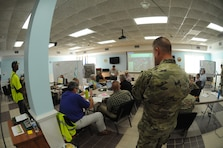 Army officials meet for the pre-construction meeting for the first contract on the recovery of Military Ocean Terminal Sunny Point, N.C., Oct. 2, 2018, after damage caused by Hurricane Florence.