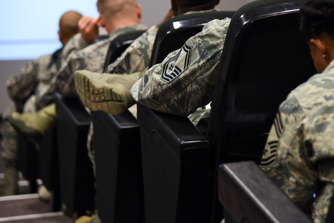 U.S. Air Forces in Europe and U.S. Air Forces Africa Squadron Superintendent and Spouse course attendees wait between briefings at the USAFE conference center on Ramstein Air Base, Germany, Sept. 25, 2018. USAFE leadership recognized the need for training at the superintendent level and created the course geared towards superintendents who have been in the position less than a year and those who have been vectored toward the job. (U.S. Air Force photo by Airman D. Blake Browning)