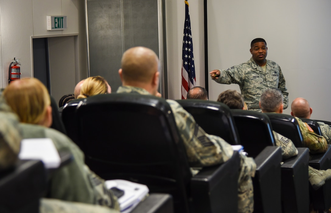 Chief Master Sgt. Phillip L. Easton, U.S. Air Forces in Europe and U.S. Air Forces Africa command chief master sergeant, presents a briefing on the role of a squadron superintendent at the USAFE-AFAFRICA Squadron Superintendent and Spouse course at the USAFE conference center on Ramstein Air Base, Germany, Sept. 25, 2018. During the course, superintendents were able to panel current squadron superintendents, meet with senior mentors, and also network among one another. (U.S. Air Force photo by Airman D. Blake Browning)