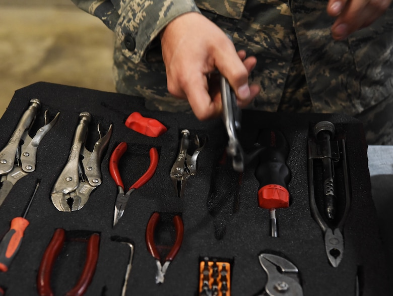 Airman 1st Class Casey Pelt, a 28th Aircraft Maintenance Squadron B-1 crew chief, checks out tools before he starts his shift at Ellsworth Air Force Base, S.D., Sept. 11, 2018. The 28th Maintenance Squadron tool crib maintains, distributes and accounts for a multitude of equipment used by Airmen in the 37th and 34th Bomb Squadrons for maintenance and repair of the base's fleet of B-1s. (U.S. Air Force photo by Airman 1st Class Thomas Karol)