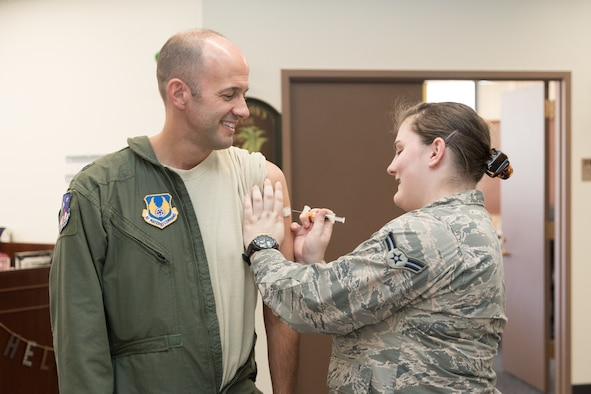 Brig. Gen. E. John Teichert, 412th Test Wing commander, receives his annual flu vaccination from Airman 1st Class Jessica Davidson, 412th Medical Operations Squadron, outside his office Sept. 26 (U.S. Air Force photo by Don Allen)