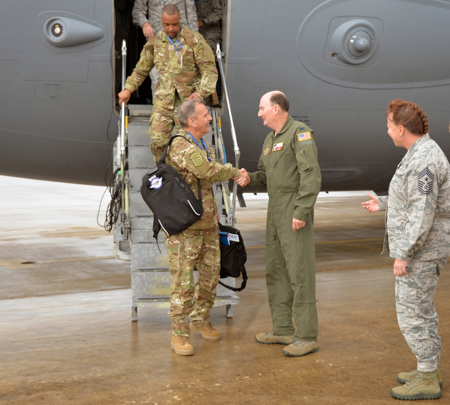 Maj. Gen. Randall A. Ogden, 4th Air Force commander, and 4th AF Command Chief Master Sgt. Timothy C. White Jr. deplane and are greeted by Col. Thomas K. Smith Jr., 433rd Airlift Wing commander, and 433rd AW Command Chief Master Sgt. Shana C. Cullum at Joint Base San Antonio-Lackland, Texas Oct. 1, 2018.