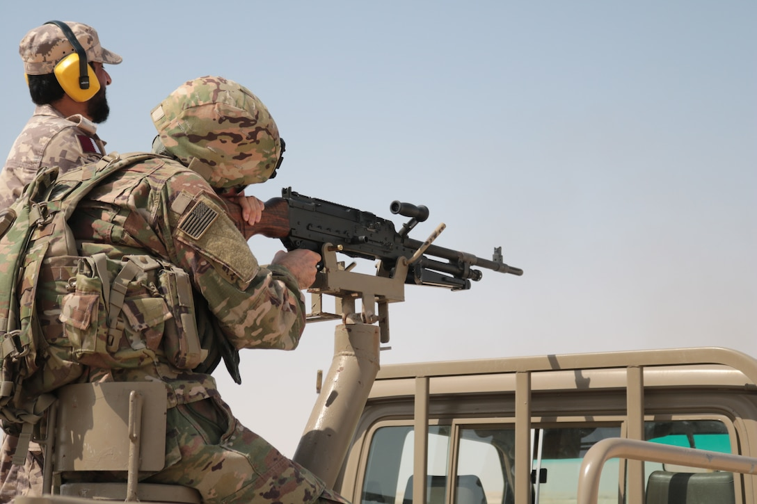 A U.S. Soldier with the 578th Brigade Engineer Battalion fires down range as a Qatari safety observes his target at Al-Ghalail range, Sep. 12, 2018. The range provided a unique opportunity for Soldiers to build rapport with the Qatari soldiers from a Qatari base near Camp As Sayliyah. (U.S. Army photo by 1st. Lt. Stefan Tenorio)
