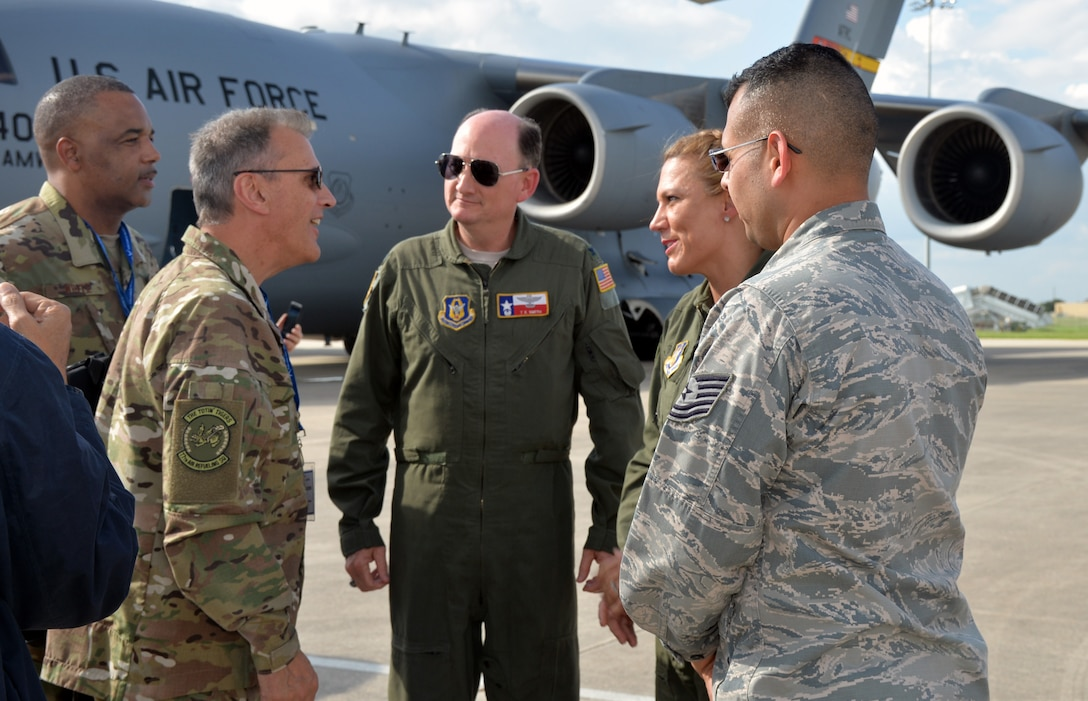 Maj. Carolyn L. Stateczny, a flight nurse, and Tech Sgt. Edgar Ramirez, aeromedical evacuation technician, 433rd Aeromedical Evacuation Squadron, speak with to Maj. Gen. Randall A. Ogden, 4th Air Force commander, Oct 1, 2018 at Joint Base San Antonio-Lackland, Texas about how their crew saved a man's life Sept. 19, 2018 while on a commercial flight from Dallas to Washington D.C.