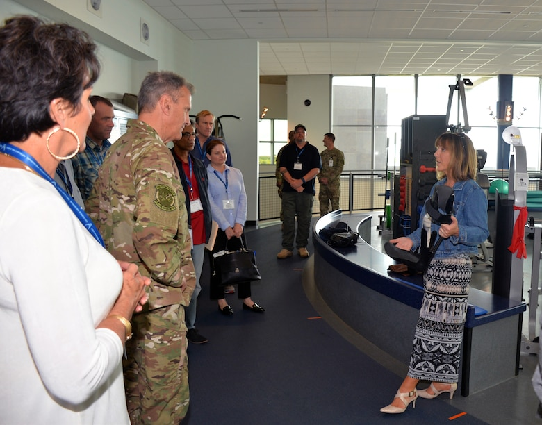 Lori Leal, Center for the Intrepid secretary, describes an Intrepid Dynamic Exoskeleton Orthosis at the Center for the Intrepid to a group of civic leaders from the March Air Reserve Base, California area at Joint Base San Antonio-Fort Sam Houston, Texas Oct. 1, 2018.