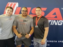 Senior Airman Zachary Nelson, left, Tech. Sgt. Nick Soriano, middle, and Staff Sgt. Christopher LaCour, right, pose for a photo during the Northwest Regional USA Powerlifting Competition July 29, 2018. Nelson placed second in the 74 kg weight class and LaCour place second in the 93 kg weight class which qualified them for Nationals in Spokane, Washington, Oct. 11-15, 2018.