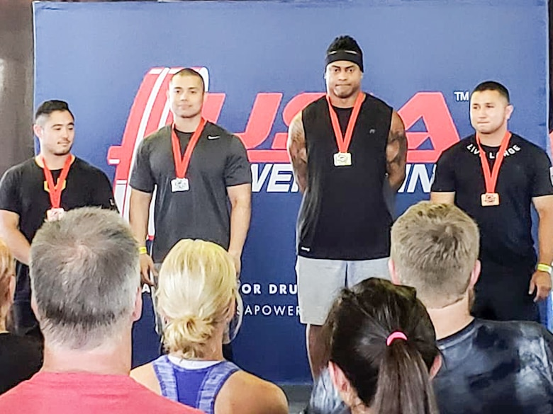 Staff Sgt. Christopher LaCour, second from left, a mission systems technican with the 225th Support Squadron, places second in the 93 kg weight class during the Northwest Regional USA Powerlifting Competition July 29, 2018.   LaCour qualified for Nationals in Spokane, Washington, Oct. 11-15, 2018.
