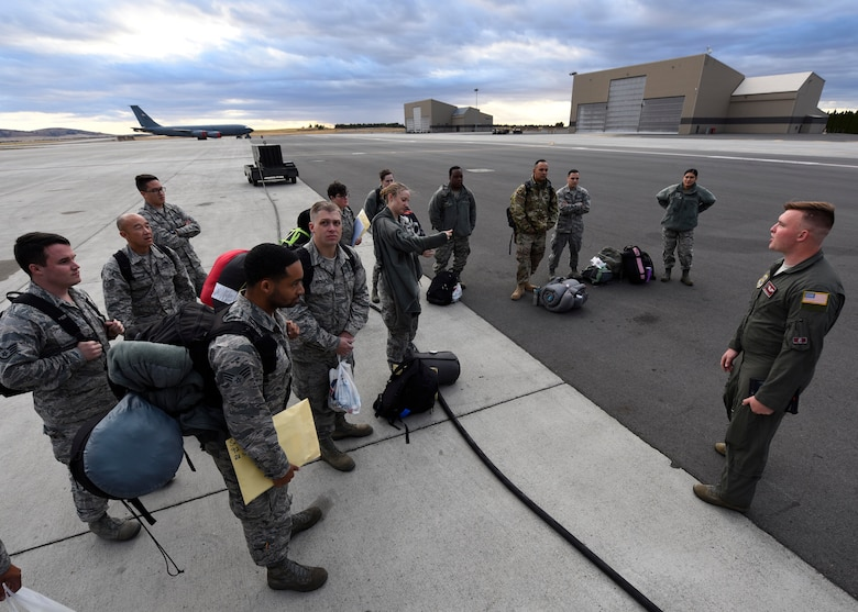 Senior Airman Daniel Daley, 384th Air Refueling Squadron in-flight refueling specialist, briefs service members prior to boarding a KC-135 Stratotanker at Fairchild Air Force Base, Washington, September 2018. Mobility Airmen fuel the fight, provide airlift needed for supplies and personnel, and enable versatile and timely effects through contingency response ensuring mission success. (U.S. Air Force photo/Airman 1st Class Lawrence Sena)
