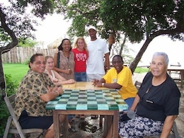 Elizabeth Decelles (standing in the middle) with her community development gruop in Jamaica.