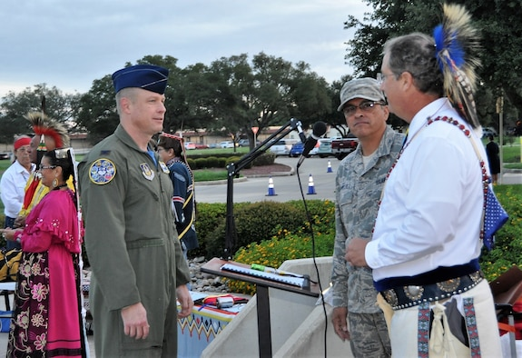 Col. Allen Duckworth, commander of the 340th Flying Training Group, JBSA-Randolph, Texas, talks with Master Sgt. Robert Sanchez, 340th FTG education and training chief and event co-officiator, Edward Blauvelt (from the Muscogee tribe), Randolph American Committee chair and vice chair of the Traditional American Indian Society, prior to 2018 Texas American Indian Heritage Day events held here Sept. 28. (U.S. Air Force photo by Janis El Shabazz)