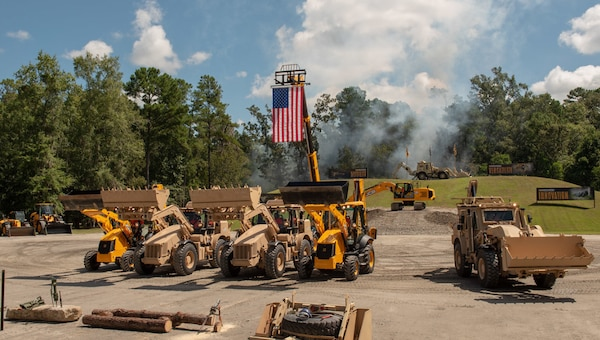 Outside photo of the American flag and multiple excavators