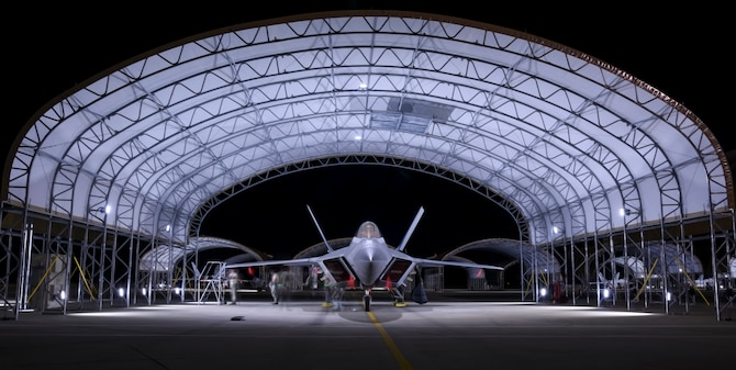 U.S. Air Force Airmen assigned to the 94th Aircraft Maintenance Unit and the 27th Fighter Wing finish inspecting an F-22 Raptor at Joint Base Langley-Eustis, Va., June 26, 2017. The newly built sun shelters are equipped with lights that illuminate the entire aircraft during hours of darkness, allowing those working under them to have better visualization. (U.S. Air Force photo/Airman 1st Class Tristan Biese)
