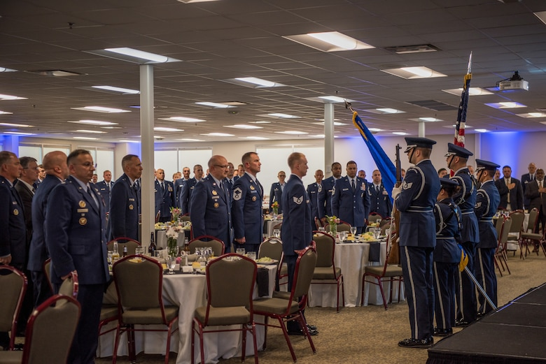 The 137th Special Operations Wing Honor Guard presents the colors at the 2018 Air National Guard Security Forces Squadron Dinner and Awards Banquet at the National Center for Employee Development Conference Center in Norman, Okla., Sept. 12, 2018. Every year, leadership from all of the Air National Guard security forces squadrons meet in one place to discuss past, current and upcoming topics that impact the career field, as well as recognize outstanding security forces Airmen. (U.S. Air National Guard Photo by Staff Sgt. Kasey M. Phipps)